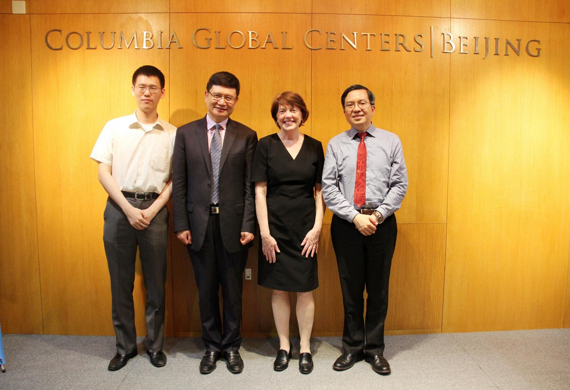 group photo of four School of Engineering and Applied Science faculty in front of the Global Centers Beijing sign
