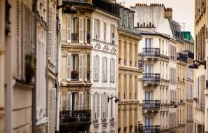 balcony view down a Paris street corridor
