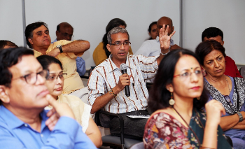 people at a discussion event in Mumbai