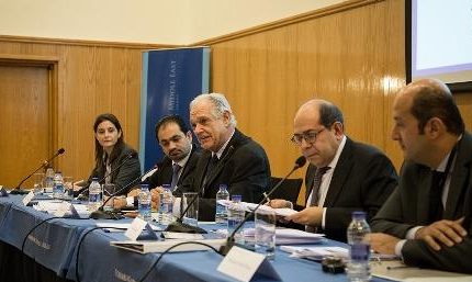 Five participants sitting at a panel in Amman, Jordan