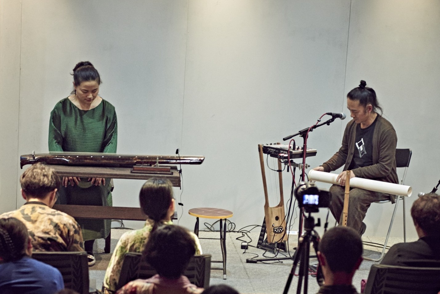 two artists playing instruments at beijing center