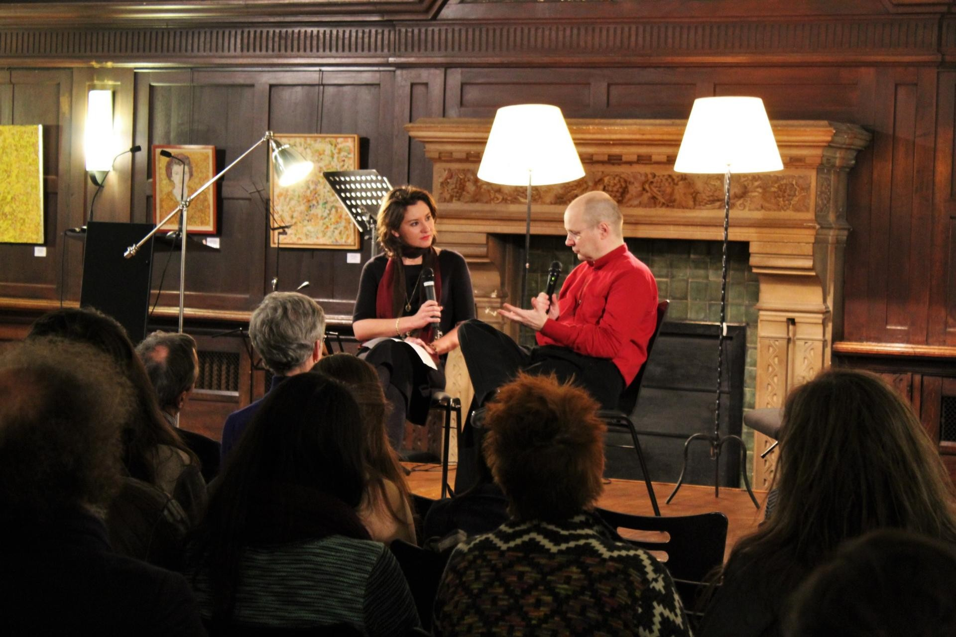 people on stage in discussion at the paris center