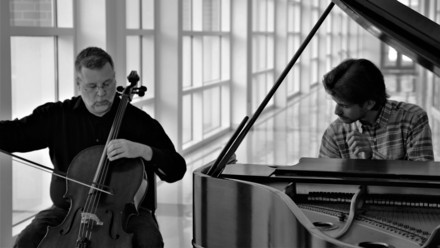 Musicians playing cello and piano