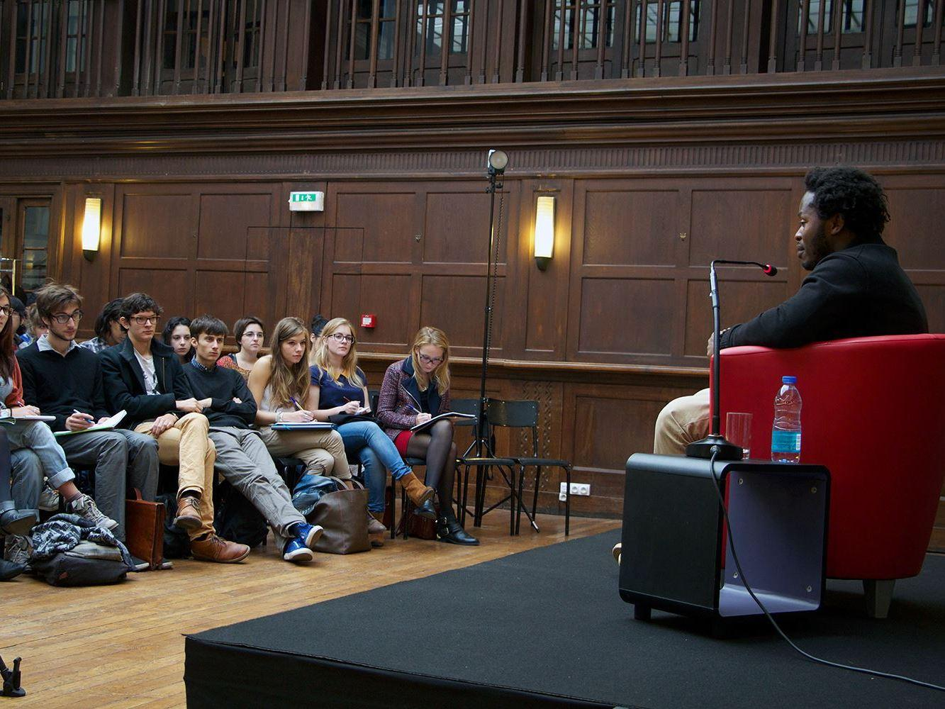 Ishmael Beah speaks with students