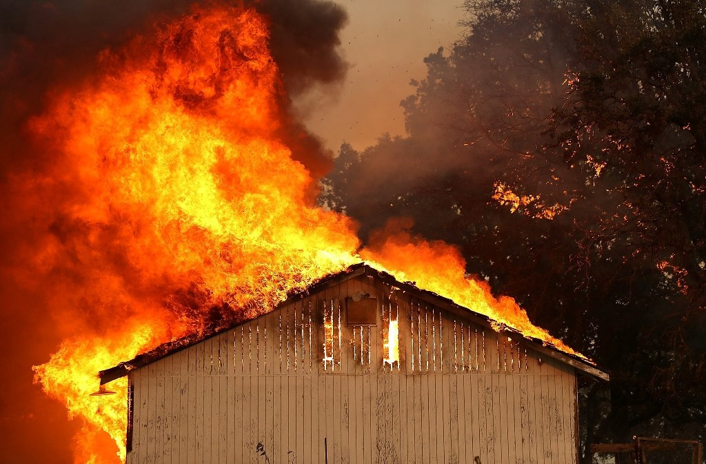 A home burns as the River Fire moves through Lakeport, Calif.CreditJustin Sullivan/Getty Images