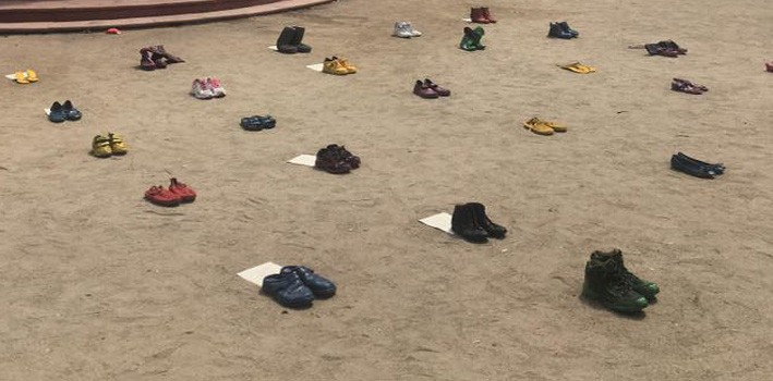 Colored shoe interactive installation each one with fragments of letters from concentration camp inmates